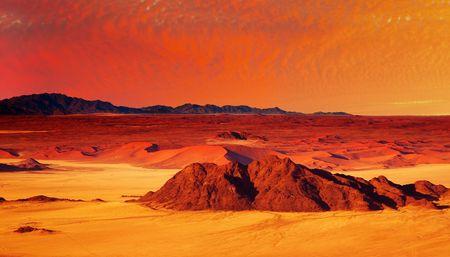 birdseye: Desert fantasy with red sunset, birds-eye view  Stock Photo