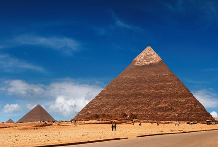 grandiose: Grandiose egyptian pyramids in Giza Stock Photo