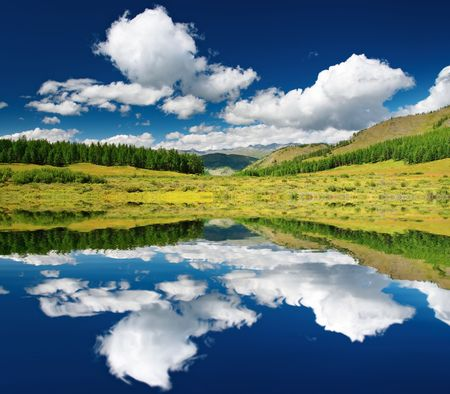 Landscape with forest and blue sky reflected in water Stock Photo - 2706554