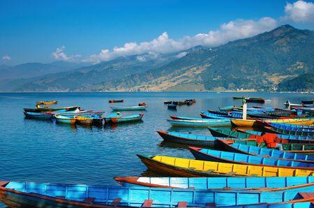Colorful boats on Fewa lake, Pokhara, Nepal Stock Photo
