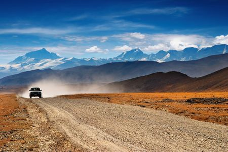 Tibetan road and mount Everest on background