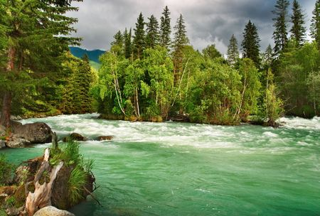 Beautiful turquoise river in Altai mountains photo