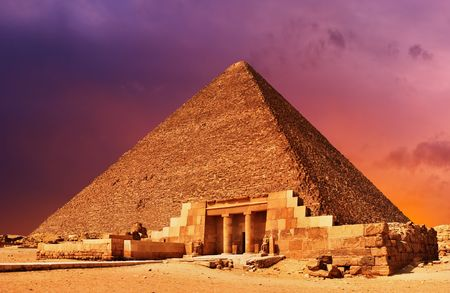 grandiose: Ancient egyptian pyramid at sunset
