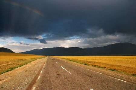 Landscape with road and storm clouds photo