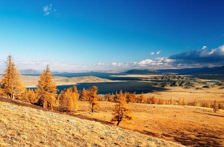 nomadism: Landscape with lake and blue sky, Western Mongolia Stock Photo