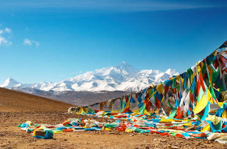 grandeur: Buddhist prayer flags and mount Everest on background  Stock Photo