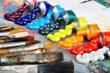 Palette with oil paint and brushes