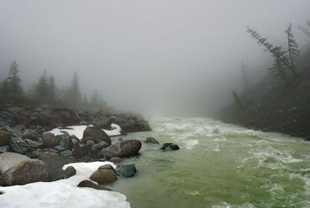 inclement weather: Foggy morning and mountain river