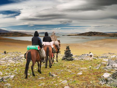 Horseriders in mongolian wildernesss Stock Photo
