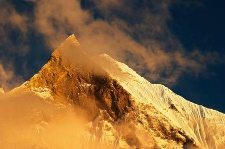 fishtail: Sunset in Himalaya, Machhapuchhre mountain in Nepal (Fishtail)  Stock Photo