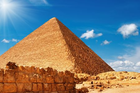 Egyptian pyramid against blue sky