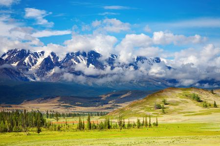 Landscape with mountain range and blue sky