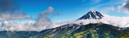 extinct: Mountain panorama with extinct volcano and cloudy sky  Stock Photo