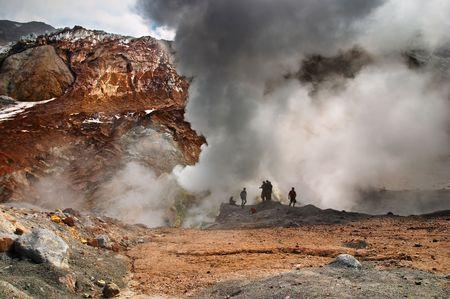 volcanic: People inside active volcanic crater, Mutnovsky volcano, Kamchatka Stock Photo