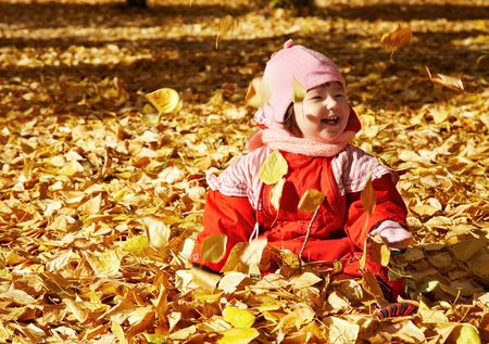 infancy:  playing with autumn leavesr
