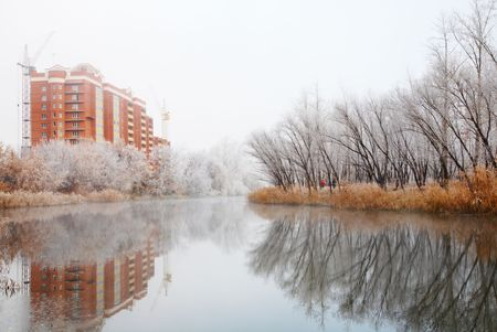 Autumn landscape with river and frosty trees photo