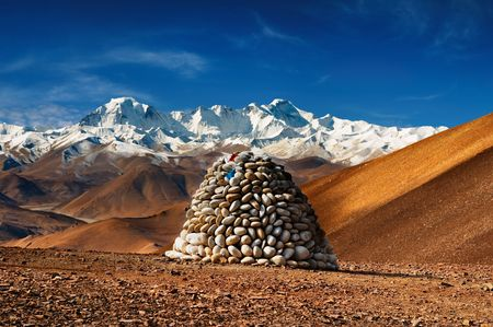 pyramid peak: Tibetan landscape with mount Cho Oyu on background