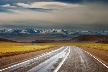 Landscape with road and snowy mountains