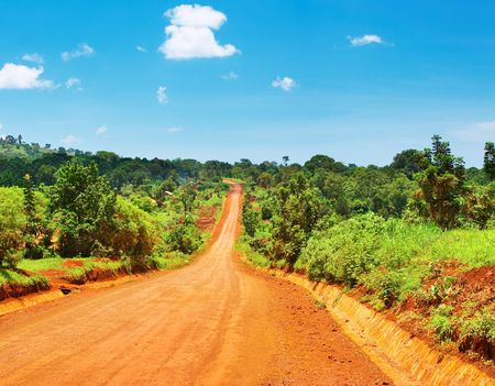 African landscape with road and blue sky, Uganda