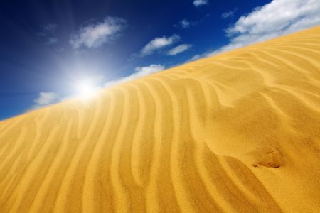 parch: Desert concept, sand dune and blue sky Stock Photo