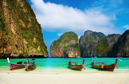 Tropical beach, traditional long tail boats, famous Maya Bay, Thailand  Stock Photo