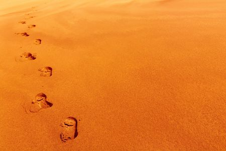 famine: Footprints on sand dune, desert concept
