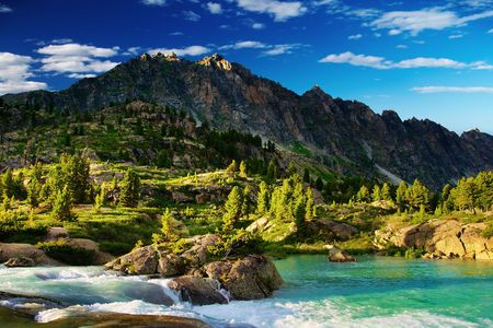 Mountain landscape with forest and lake photo