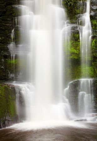 Waterfall in primeval forest, New Zealand photo