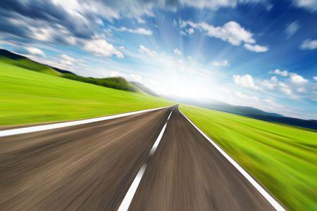 Empty road with motion blur  Фото со стока