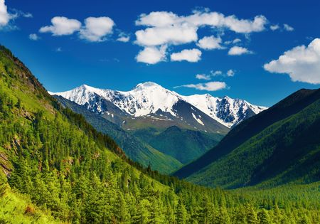 Mountain landscape with snowy mountains and blue sky