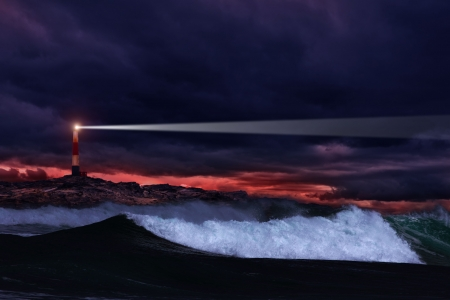Lighthouse on the rocks in storm ocean  photo