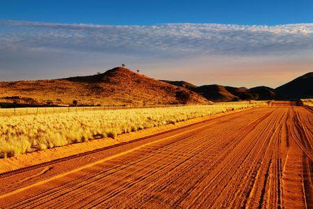 kalahari desert: Road in Kalahari Desert at sunset, Namibia