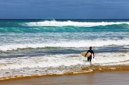 mile: Surfer at the beach, Ninety Mile Beach, New Zealand