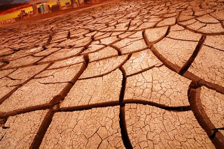 waterless: Drought concept, landscape with city and cracked land