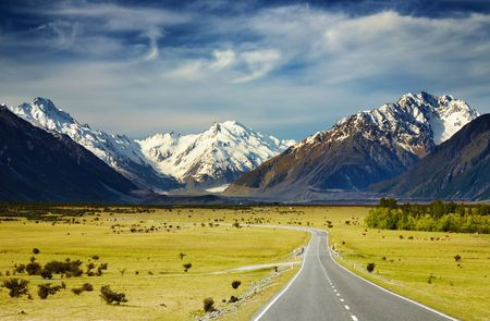panorama view: Landscape with road and snowy mountains, Southern Alps, New Zealand