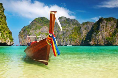 Tropical beach, traditional long tail boat, Maya Bay, Thailand photo
