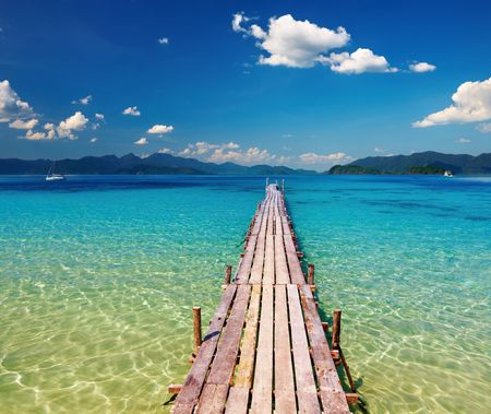 Wooden pier in tropical paradise, Thailand  Фото со стока