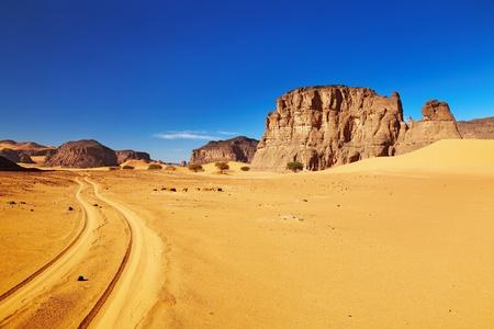 stone road: Desert landscape with rocks and blue sky, Tadrart, Algeria