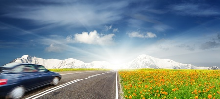 road ahead: Mountain landscape with road and moving car  Stock Photo