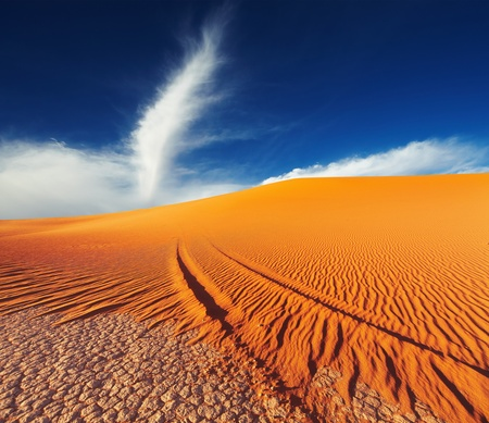 Sand dune in Sahara Desert at sunset, Tadrart, Algeria Stock Photo