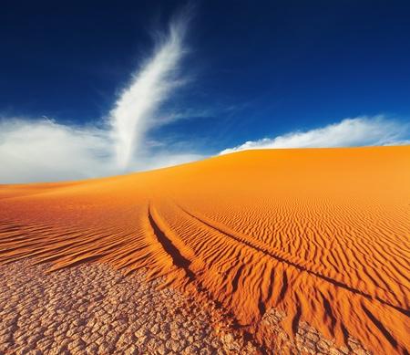 Sand dune in Sahara Desert at sunset, Tadrart, Algeria Фото со стока