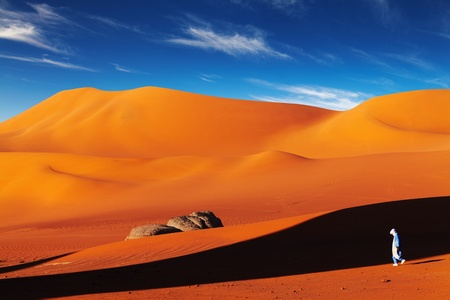 Tuareg in desert at sunset, Sahara Desert, Algeria photo
