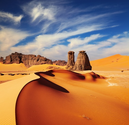 sahara: Sand dunes and rocks, Sahara Desert, Algeria Stock Photo