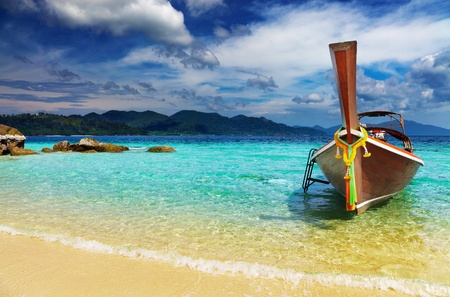 Long tail boat, Tropical beach, Andaman Sea, Thailand photo