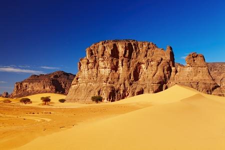 Sand dunes and rocks, Sahara Desert, Algeria photo