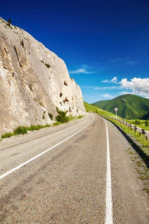 Mountain landscape with road and blue sky Stock Photo - 13727741