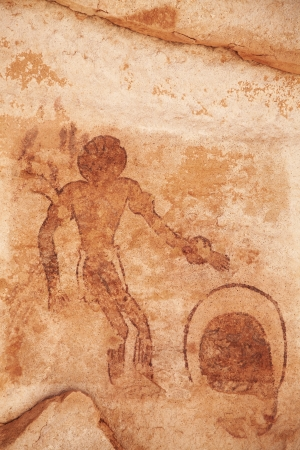 man painting: Famous prehistoric rock paintings of Tassili NAjjer, Algeria
