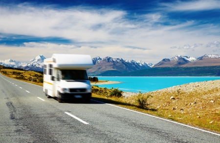 camper: Traveling by motorhome, Mount Cook, New Zealand. Car in motion blur
