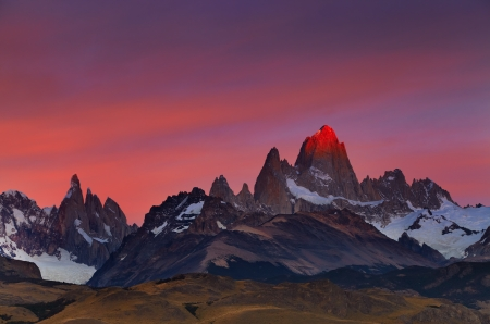 Mount Fitz Roy, alpenglow, first rays of sunrise. Los Glaciares National Park, Patagonia, Argentina photo