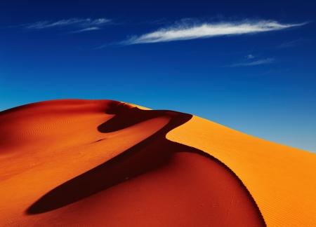 Písečné duny v poušti Sahara při západu slunce, Tadrart, Alžírsko Reklamní fotografie - 14409833
